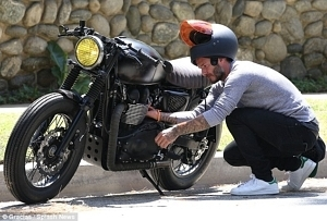 Man Checking Out His Motorcycle